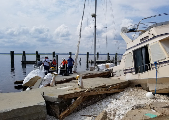 Storm cleanup at a damaged marina.